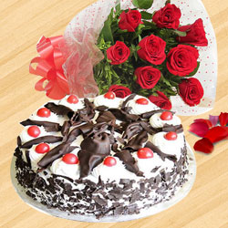 Exotic Red Color Roses Hand Bunch with Black Forest Cake to Nadia