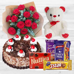 Awesome Bouquet of 12 Dutch Red Roses with 1 Lb Cake, Mixed Cadburys Chocolates and a Teddy Bear to Burdwan