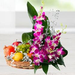 Pretty Flowers and 2 Kg. Fresh Fruits in Bamboo Basket to Howrah