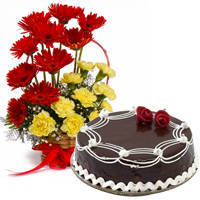 Regal Carnations and Gerberas Arrangement with 1/2 Kg Dark Chocolate Cake to Murshidabad