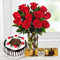 Gorgeous Bouquet of bright Red Roses, tasty Ferroro Rocher and delicious Black Forest Cake to Bakura
