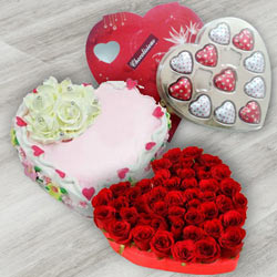 Generous 24 Red Roses, Heart Shaped Chocolate Box and 1 Lb Heart Shaped Cake to Burdwan