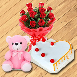 Incomparable 12 Dutch Red Roses with Teddy Bear and 1/2 Kg Heart Shaped Cake to Siliguri