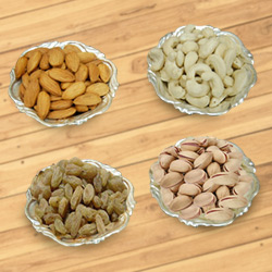 Delectable mixed Dry Fruits with Silver plated bowls to Hooghly