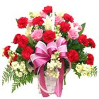 Radiant Basket of 10 Carnations in Red and 7 Roses in Pink Colour to Nadia
