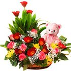 Passionate Basket of Gerbera N Roses with a Teddy to Siliguri