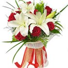 Wholesome Charm Lilies and Roses Bouquet to Burdwan