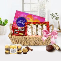 Scrumptious Basket Including Chocolates Gift Hamper for Special Day to Dumdum