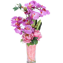 Vibrant Gift of Artificial Orchids N Roses decked in a Glass Vase<br>