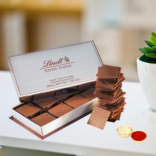 Lindt Swiss Thins with free Roli Tilak and Chawal.
