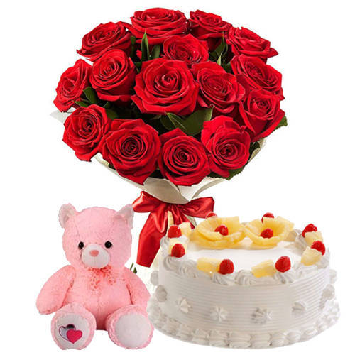 Loverly Hamper of Small Teddy, Pineapple Cake & Red Color Roses Hand Bunch
