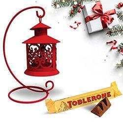 Engrossing Tea Light Decor N Toblerone Christmas Combo