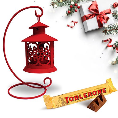 Engrossing Tea Light Decor N Toblerone Christmas Combo