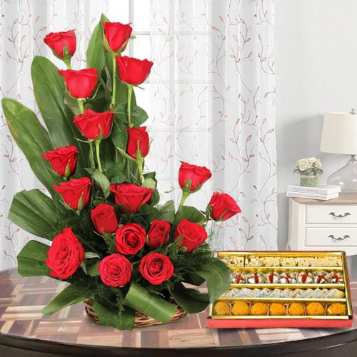 Fashionable Red Colored 18 Roses Bouquet with 1/2 Kg. Mixed Sweets