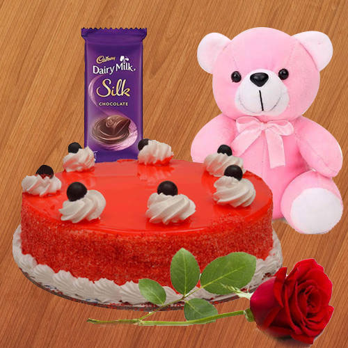 Send Online Combo of Red Velvet Cake with Cadbury Silk, Teddy N Red Rose