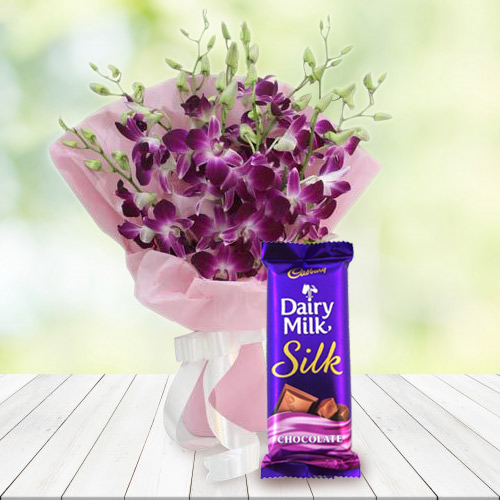 Blessed Birthday Wishes Combo of Dairy Milk Silk and Orchids Bouquet