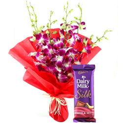 Deliver Online Bouquet of Orchids and Cadbury Dairy Milk Chocolate