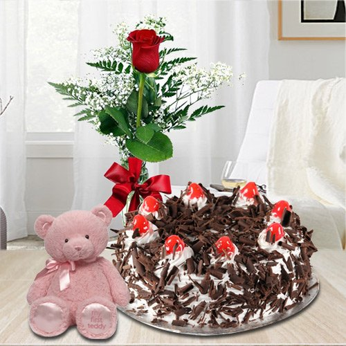 Gratifying 1 Lb Black Forest Cake with Single Red Rose and a Small Teddy Bear