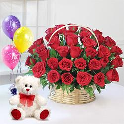 Angelic Red Roses along with a luscious Ferrero Rocher Chocolates