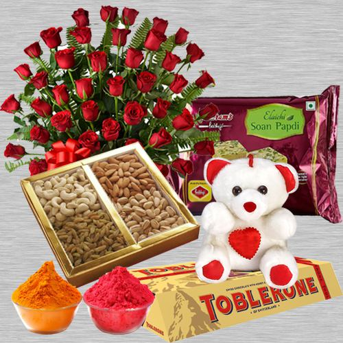 Nicely Gift Wrapped 50 Red Roses Basket Mixed Dry fruits 500 gms. Haldiram's Soan Papdi 500 gms. a small Teddy Bear and Toblerone bar 4 Pcs with free Gulal/Abir Pouch.