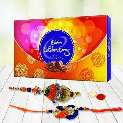 Lovely Rakhi celebration pack with Bhaiya Bhabhi Rakhi, free Roli tika and Chawal