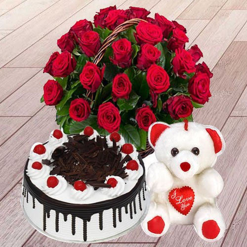 Wonderful 25 Red Roses with 1 Lb Black Forest Cake and a Teddy Bear