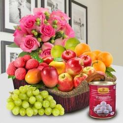 Fresh Fruits and Haldiram Rasgulla for Mummy with Pink Rose Bouquet.