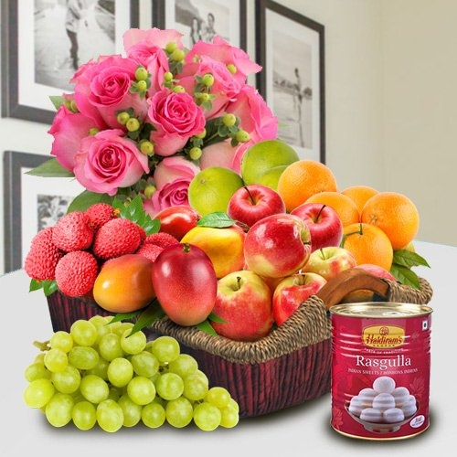 Fresh Fruits and Haldiram Rasgulla for Mummy with Pink Rose Bouquet.