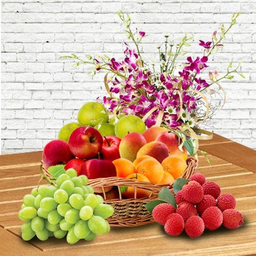 Juicy Fresh Fruits in a Orchid decorated Basket for Mummy