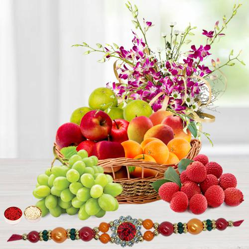 Tropical Fresh Fruits Basket decorated with Orchids with 1 Regular Rakhi and Roli Tilak Chawal