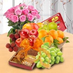 Basket of 2 kg Fresh Fruits Basket & Haldiram Soan Papdi and Pink Rose Bouquet for your Mom