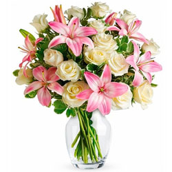 Striking Glass Vase display of White Roses N Pink Lilies