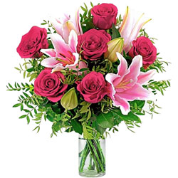Lovely Glass Vase display of Red Roses with Pink Lilies