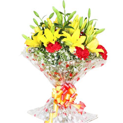 Marvelous Red Carnations with Yellow Lilies Hand Bunch