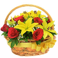 Wonderful Basket of Red Roses with Yellow Lilies
