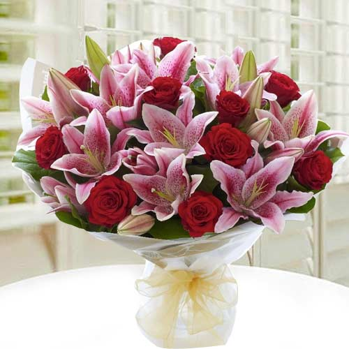 Expressive Hand Bunch of White Lilies N Red Roses