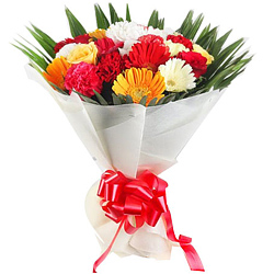 Color-Coordinated Hand Bunch of Gerberas and Carnations along with Roses