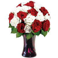 Dazzling White N Red Roses arranged in Glass Vase