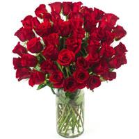 Attractive Arrangement of Red Color Roses in a Glass Vase