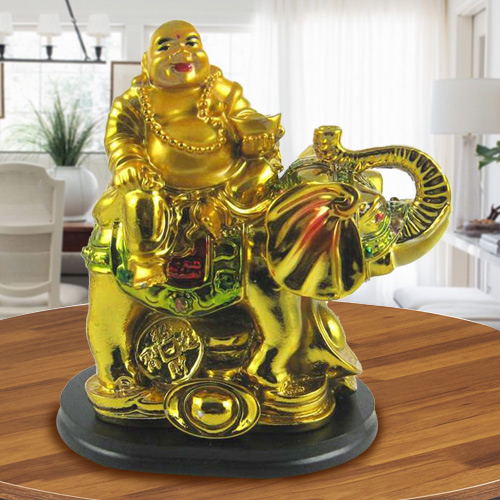 Laughing budha sitting on elephant