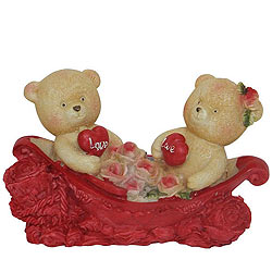Cheerful Couple Teddy With Two Hearts and Roses in a Boat