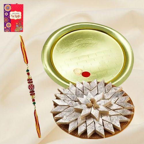 Kaju Katli and Silver Plated Puja Thali along Rakhi, Roli, Tilak and Chawal