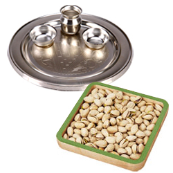 Outstanding Composition of Silver Thali and Roasted Pistachio for Diwali Celebration