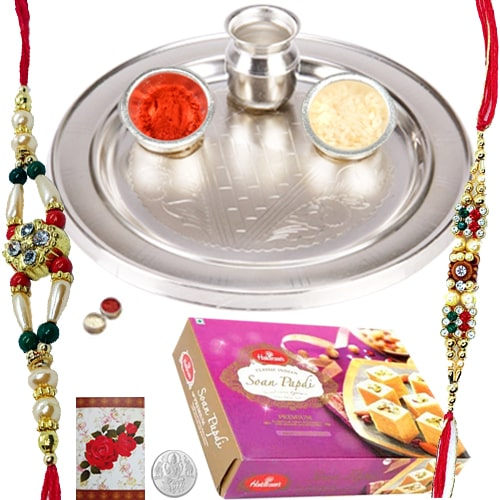 Delightful Rakhi Teamed with Thali and 250 Gms. Soan Papdi from Haldiram